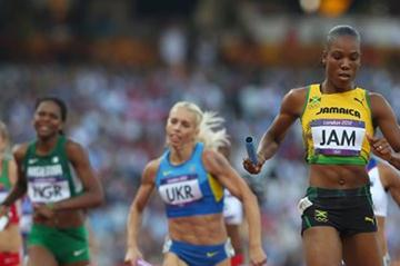 Rosemarie Whyte of Jamaica crosses the finish line and qualifies her team for the  Women's 4 x 400m Relay final  of the London 2012 Olympic Games on 10 August 2012 (Getty Images)