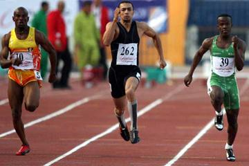 Gold medallist Amr Ibrahim Mostafa Seoud of Egypt (C), silver medalist Saudi Yahya Said (R) and bronze medalist Khalil Hamad of Jordan compete at the men's 100m race during the 11th Pan Arab Games (AFP / Getty Images)