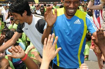 Marathon world record holder Haile Gebrselassie (right) of Ethiopia and Arata Fujiwara of Japan (left) take part in the National Running Day festivities in New York (organisers)