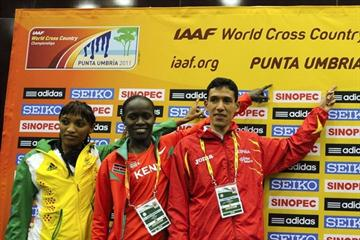 Ayad Lamdassem of Spain with Meselech Melkamu (ETH) and Linet Chepkurui (KEN) at the IAAF World Cross Country Championships Press Conference in Punta Umbria (Getty Images)