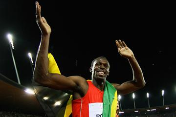 Usain Bolt celebrates his 100m win (Getty Images)