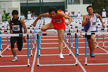 Lu Jiateng (China) leading his way to 110m hurdles victory (Freelance)