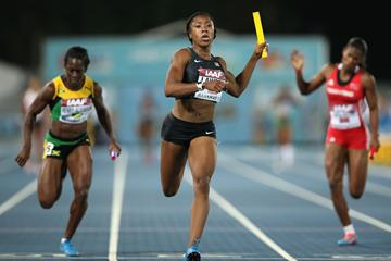 LaKeisha Lawson of the United States crosses the finish line ahead of Samantha Henry-Robinson (L) of Jamaica and Kai Selvon (R) of Trinidad and Tobago to win the Women's 4x100 metres relay during day one of the IAAF World Relays (Getty Images)