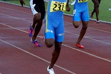 Aaron Armstrong wins the national championships in 19.98 (+2.1m/s) (Dexter Philip - Trinidad Express)