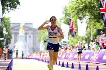 Bertrand Moulinet of France salutes the crowd as he crosses the line during the Men's 50km Walk of the London 2012 Olympic Games on The Mall on August 11, 2012 (Getty Images)
