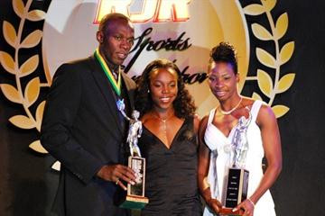 Usain Bolt (left), Veronica Campbell-Brown (centre) and Melaine Walker pose with their Jamaican Sportsman of the Year awards (SportingEagle Photo)