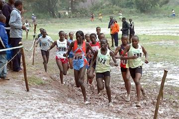 Pauline Korikwiang (red vested, far left of the front trio) running the 8km XC in Machakos, Kenya (Elias Makori)