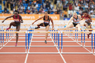 Dawn Harper Nelson (left) wins the 100m hurdles at the 2014 IAAF Diamond League in Birmingham (Jean-Pierre Durand)