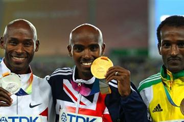 Mohamed Farah of Great Britain celebrates with his gold medal , Bernard Lagat of the USA the silver and Dejen Gebremeskel of Ethiopia the bronze, during the medal ceremony for the men's 5000 metres final  (Getty Images)