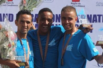 Aziz Naji Idrissi (c) on the Casablanca Marathon podium (Mohammed Benchrif)