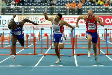 Ladji Doucoure dips on the line to take 60m hurdles gold (Getty Images)