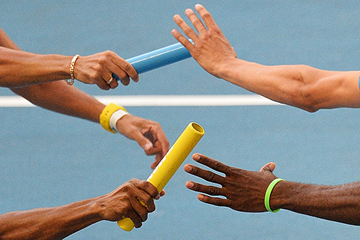 Athletes pass the baton during the 4x400m (AFP / Getty Images)