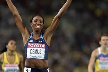 Lashinda Demus of United States celerates with her country's flag after claiming gold in the women's 400 metres hurdles final during day six  (Getty Images)