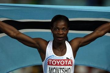 Amantle Montsho of Botswana celebrates with her country's flag after winning the women's 400 metres final  (Getty Images)