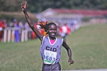 World 5000m champion Vivian Cheruiyot crosses the finish line to win the women's 8km race at the Kenya Police National Cross Country Championships at the Ngong Racecourse in Nairobi (MOHAMMED AMIN/DAILY NATION)