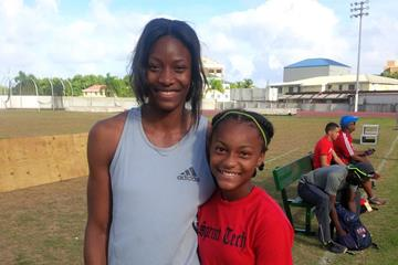Shaunae Miller with young fan (Claude Bryan)