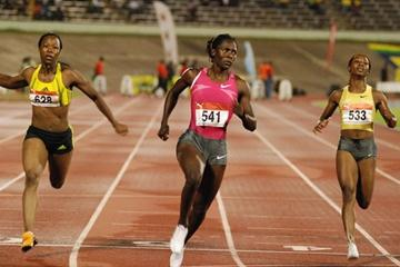 Jamaica's Kerron Stewart (c) finishes ahead of Olympic champion Shelly-Ann Fraser (right) and American Marshavet Hooker at the Jamaica International in Kingston. Stewart won in a world leading 10.92. (Anthony Foster)
