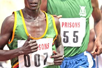 World marathon champion Luke Kibet leads Daniel Too in the 10,000m at the Kenya Prisons champs. Kibet won the race. (Elias Makori)