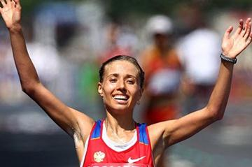 Gold medalist Olga Kaniskina of Russia celebrates as she crosses the finish line during the women's 20km race walk during day five  (Getty Images)
