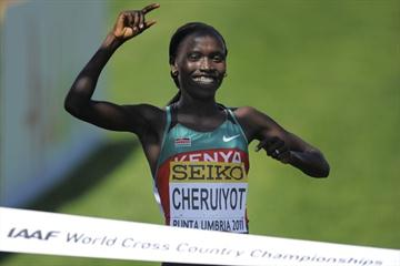 Vivian Cheruiyot of Kenya celebrates winning the women's senior race at the IAAF World Cross Country Championships in Punta Umbria (Getty Images)