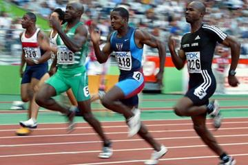 Tim Montgomery and Kim Collins in the men's 100m semi final (Getty Images)