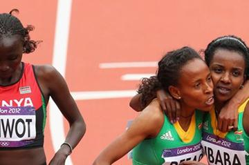 (L-R) Viola Jelagat Kibiwot of Kenya, Meseret Defar and Tirunesh Dibaba of Ethiopia look on after the Women's 5000m round 1 heats on Day 11 of the London 2012 Olympic Games on 7 August 2012 (Getty Images)