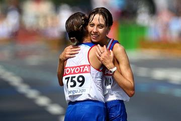 Gold medalist Olga Kaniskina (L) of Russia celebrates with bronze medalist Anisya Kirdyapkina of Russia after crossing the finish line during the women's 20km Race Walk  (Getty Images)