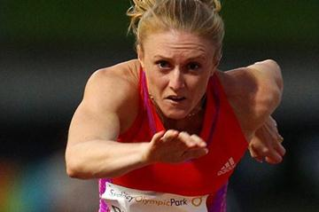 Sally Pearson in flight in Sydney (Getty Images)