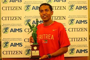 Zersenay Tadese receiving the AIMS/Citizen World's Fastest Time Award (Freelance)