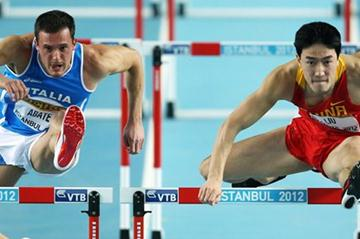 (L-R) Emanuel Abate of Italy and Lui Xiang of China competes in the Men's 60 Metres Hurdles semi final during day three - WIC Istanbul  (Getty Images)
