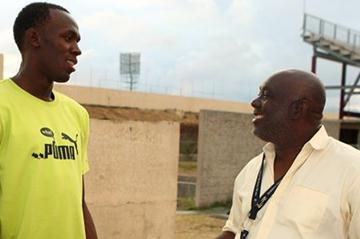 Usain Bolt with coach Glen Mills in Kingston (Getty Images)