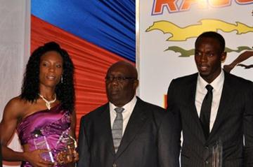 IAAF Vice President Sebastian Coe, Rosemarie Whyte, Glen Mills, Usain Bolt, Jamaican Prime Minister Portia Simpson Miller, and Yohan Blake in Kingston (Organisers)