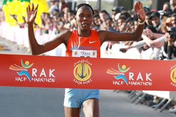 Priscah Jeptoo winning at the 2014 RAK Half Marathon (Victah Sailer / organisers)