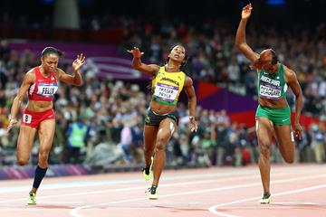 Shelly-Ann Fraser-Pryce of Jamaica crosses the line to win the gold ahead of Allyson Felix of the United States (L) and Blessing Okagbare of Nigeria (R) in the Women's 100m Final on Day 8 of the London 2012 Olympic Games at Olympic Stadium on August 4, 2012  (Getty Images)