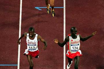 Daham Najem Bashir of Qatar (left) wins the 1500m from Belal Mansoor at the Asian Games (Getty Images)
