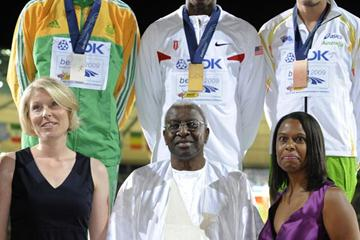 Dwight Phillips (TopC), Godfrey Khotso Mokoena (TopL) and Mitchell Watt (TopR) pose with (FirstRow,FromL) Luz Long's grandaughter Julia-Vanessa, IAAF President  Lamine Diack and Jesse Owens' grandaughter Marlene Dortch on the podium of the men's Long Jump (JOHN MACDOUGALL/AFP/Getty Images)