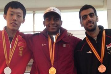 Men's High Jump podium in Hangzhou: champion Mutaz Essa Barshim (c), silver medallist Zhnag Guowei (l), and Ghazal Majd Eddin (r) with Maurice Nicholas, Honorary Secretary of the Asian Athletics Association (Yukio Seki)