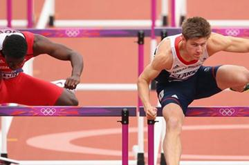 Wayne Davis of Trinidad and Tobago and Lawrence Clarke of Great Britain competes in the Men's 110m Hurdles Round 1 Heats on Day 11 of the London 2012 Olympic Games on 7 August 2012 (Getty Images)