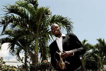 Usain Bolt poses with his 2010 Laureus World Sportsman of the Year Award (Getty Images)