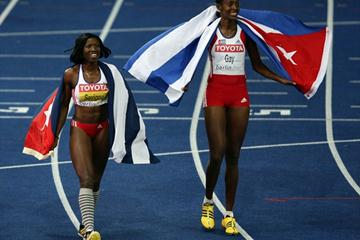 Cubans Yargelis Savigne (L) and Mabel Gay (R) celebrate winning the gold and silver medals in the women's Triple Jump final at the 12th IAAF World Championships in Athletics (Getty Images)