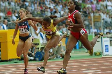 Perdita Felicien of Canada wins the 100m Hurdles (Getty Images)