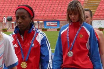 Cuba's Jarianna Martinez leads the Triple Jump medallists at the World University Games (Hans van Kuijen)