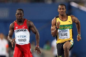 Justyn Warner (L) of Canada and Yohan Blake of Jamaica compete in the men's 100 metres heats during day one  (Getty Images)