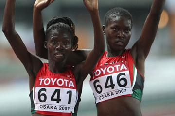 Eunice Jepkorir (641) and Ruth Bisibori Nyangau of Kenya celebrate finishing third and fourth in the women's steeplechase final (Getty Images)