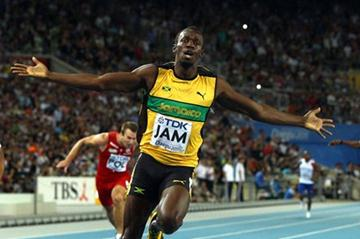 Usain Bolt of Jamaica celebrates victory and a new world record in the men's 4x100 metres relay final  (Getty Images)