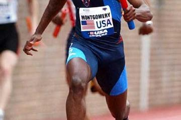 Tim Montgomery anchors home at the 2003 Penn Relays (Kirby Lee)