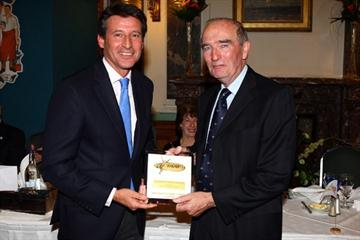 Vice-president Seb Coe presents an IAAF Plaque to David Littlewood (Getty Images)