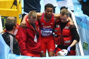 Ernesto Reve is carried off the infield after injuring his leg during the triple jump at the 2014 IAAF World Indoor Championships in Sopot (Getty Images)