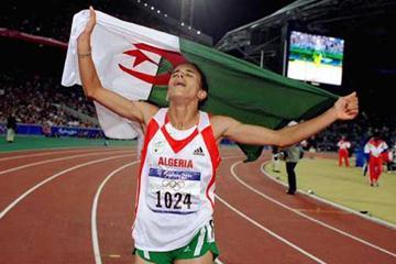 Nouria Merah- Benida celebrates with Algerian flag in Sydney (Getty Images)