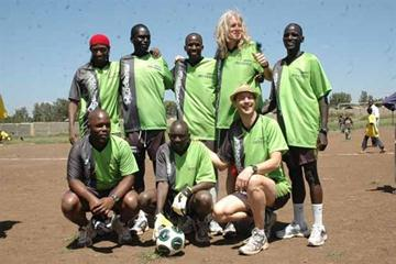 Shoe4Africa All Star team at the Kibera slums in Nairobi Saturday. Back Row l to r: Douglas Wakiihuri, Robert Cheruiyot, Martin Lel, Toby Tanser and Christopher Cheboiboch; Front Row, l to r: Elias Makori, Mathew Birir and Anthony Edwards (CHRIS OMOLLO (Daily Nation))